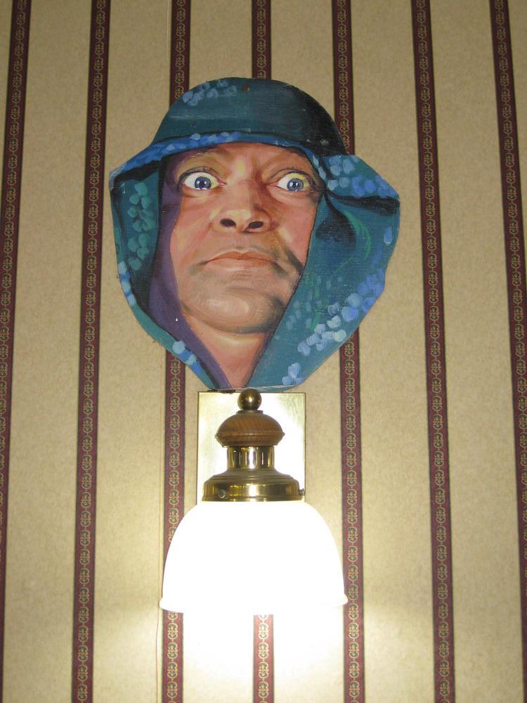 Abdullah the Butcher above a lamp