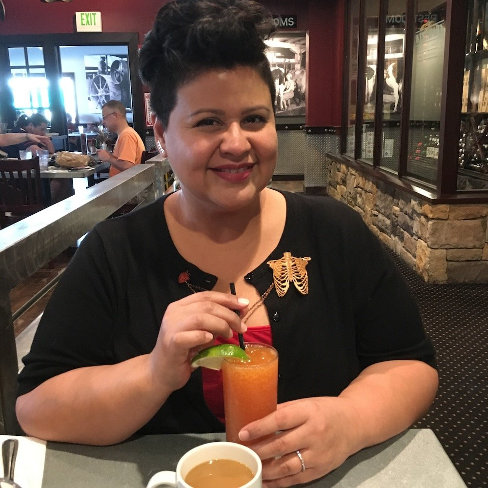 Marcela with her cocktail