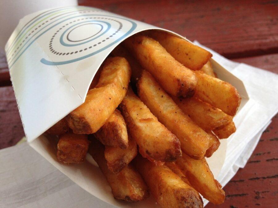 Seasoned Fries in cardboard french fry sleeve