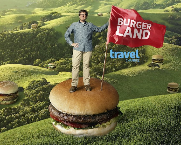 George Motz standing on giant burger